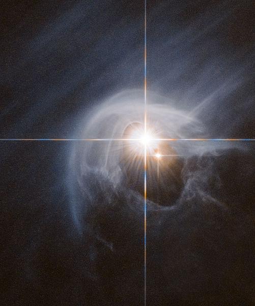https://upload.wikimedia.org/wikipedia/commons/thumb/9/99/Variable_Star_DI_Cha.jpg/501px-Variable_Star_DI_Cha.jpg