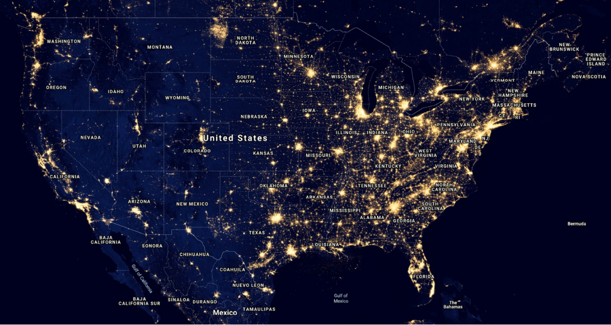 Satellite image of the United States at night, showing areas of high light concentration.